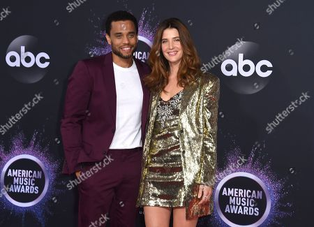 Michael Ealy, Cobie Smulders. Michael Ealy, left, and Cobie Smulders arrive at the American Music Awards, at the Microsoft Theater in Los Angeles