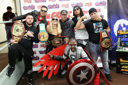Celebrity Boxing CEO Damon Feldman poses with his boxers and Cosplay
