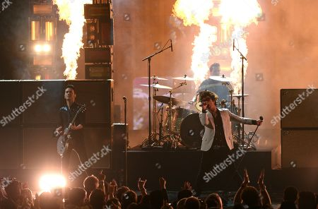 Tre Cool, Billie Joe Armstrong. Tre Cool, left, and Billie Joe Armstrong, of Green Day, perform a medley at the American Music Awards, at the Microsoft Theater in Los Angeles