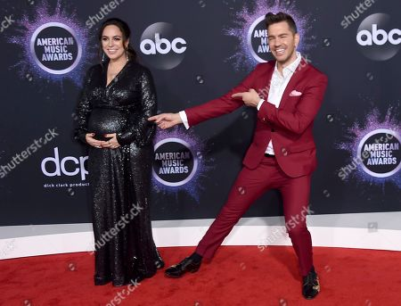 Aijia Grammer, Andy Grammer. Aijia Grammer, left, and Andy Grammer arrive at the American Music Awards, at the Microsoft Theater in Los Angeles