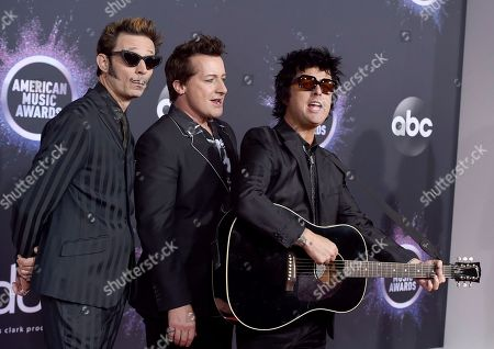 Mike Dirnt, Billie Joe Armstrong, Tre Cool. Mike Dirnt, from left, Tre Cool, and Billie Joe Armstrong, of Green Day, arrive at the American Music Awards, at the Microsoft Theater in Los Angeles