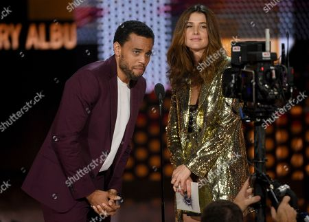 Michael Ealy, Cobie Smulders. Michael Ealy, left, and Cobie Smulders present the award for favorite country album at the American Music Awards, at the Microsoft Theater in Los Angeles