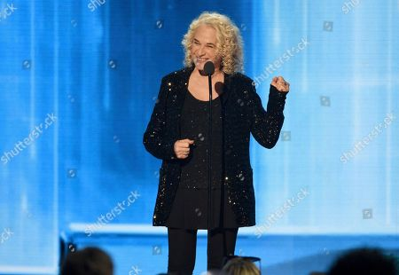 Carole King presents the award for artist of the decade at the American Music Awards, at the Microsoft Theater in Los Angeles