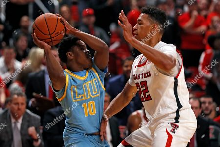 Stock Picture of Jermaine Jackson Jr., TJ Holyfield. Long Island's Jermaine Jackson Jr. (10) looks to pass the ball around Texas Tech's TJ Holyfield (22) during the first half of an NCAA college basketball game, in Lubbock, Texas