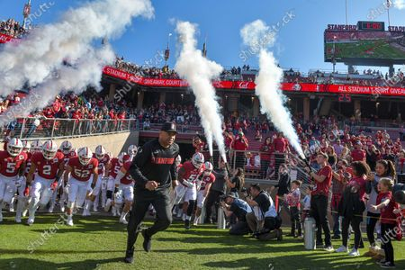 Stanford Cardinal head coach David Shaw leads his team on to field before the NCAA football game between the California Golden Bears and the Stanford Cardinal at Stanford Stadium in Stanford, California