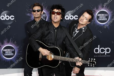 Mike Dirnt, Billie Joe Armstrong and Tre Cool of the band Green Day arrive for the 2019 American Music Awards at MMicrosoft Theater L.A. LIVE in Los Angeles, California, USA, 24 November 2019.