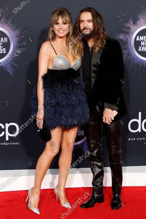 Heidi Klum (L) and husband German musician Tom Kaulitz (R) arrive for the 2019 American Music Awards at MMicrosoft Theater L.A. LIVE in Los Angeles, California, USA, 24 November 2019.