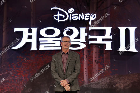 """Director Chris Buck, poses for the media before a press conference for his new movie """"Frozen 2"""" in Seoul, South Korea"""