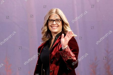 "Director Jennifer Lee waves upon her arrival at a press conference for her new movie ""Frozen 2"" in Seoul, South Korea"