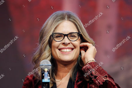 "Director Jennifer Lee smiles during a press conference for her new movie ""Frozen 2"" in Seoul, South Korea"