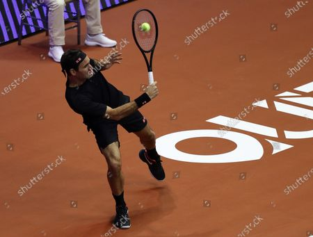 Stock Photo of Roger Federer of Switzerland in action against the Alexander Zverev of Germany, during an exhibition match at the Ruminahui Coliseum in Quito, Ecuador, 24 November 2019.