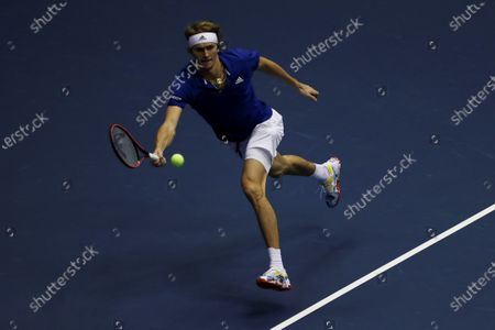 Alexander Zverev of Germany in action against Roger Federer of Switzerland during an exhibition match at the Ruminahui Coliseum in Quito, Ecuador, 24 November 2019.