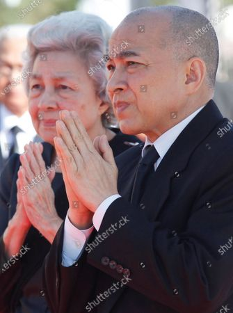 Cambodian King Norodom Sihamoni (R) and his mother Queen Norodom Monineath (L) attend the funeral ceremony for Princess Norodom Buppha Devi, one of lat?e King Norodom Sihanouk's daughters, in Phnom Penh, Cambodia, 25 November 2019. Thousands of Cambodians gathered to honor Princess Norodom Buppha Devi before her cremation after she passed away on 18 November 2019 at a hospital in Thailand at the age of 76.