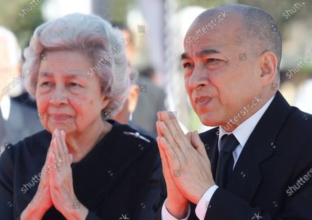 Cambodian King Norodom Sihamoni (R) and his mother Queen Norodom Monineath (L) attend the funeral ceremony for Princess Norodom Buppha Devi, one of late King Norodom Sihanouk's daughters, in Phnom Penh, Cambodia, 25 November 2019. Thousands of Cambodians gathered to honor Princess Norodom Buppha Devi before her cremation after she passed away on 18 November 2019 at a hospital in Thailand at the age of 76.