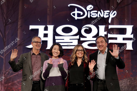 "From left, Director Chris Buck, animation supervisor Hyun-Min Lee, director Jennifer Lee and producer Peter Del Vecho, wave for the media before a press conference for their new movie ""Frozen 2"" in Seoul, South Korea"