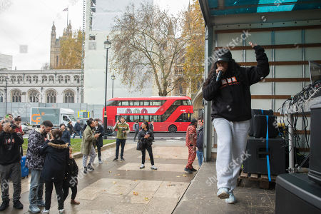 Stock Picture of Independent youth campaigners, Rize Up host guerilla gig on Parliament Square with Lady Leshurr to encourage marganilised young people to register to vote by 26th November deadline.