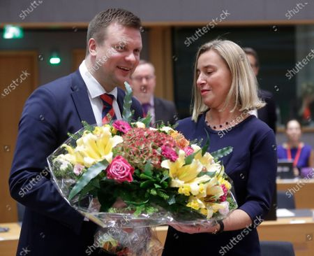 European Union Foreign Policy chief Federica Mogherini (R) receives flowers from Finnish Minister for Development Cooperation and Foreign Trade, Ville Skinnari (L) as she attends her last council meeting the EU Foreign Affairs Council (development) meeting in Brussels, Belgium, 25 November 2019. European Commissioner-designate as High Representative of the Union for Foreign Affairs and Security Policy, Spanish, Josep Borrell will take over the job from 1 December