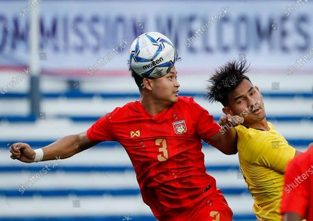 Stock Photo of Ye Min Thu (L) of Myanmar in action against Muhammad Abdul Razak (R) of Malaysia during the SEA Games 2019 men's football first round match between Malaysia and Myanmar in Manila, Philippines, 25 November 2019.