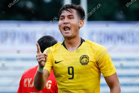 Muhammad Abdul Razak of Malaysia celebrates after scoring a goal against Myanmar during the SEA Games 2019 men's football first round match between Malaysia and Myanmar in Manila, Philippines, 25 November 2019.