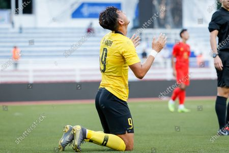 Stock Image of Muhammad Abdul Razak of Malaysia reacts after scoring a goal against Myanmar during the SEA Games 2019 men's football first round match between Malaysia and Myanmar in Manila, Philippines, 25 November 2019.