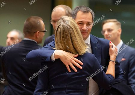 European Union foreign policy chief Federica Mogherini, left, speaks with Belgium's Minister for Development Alexander De Croo during a meeting of EU foreign ministers at the EU Council building in Brussels