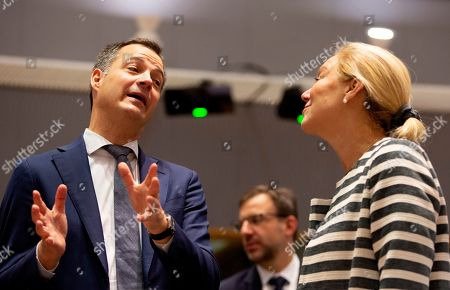 Belgium's Minister for Development Alexander De Croo, left, speaks with Dutch Minister for Foreign Trade and Development Cooperation Sigrid Kaag during a meeting of EU foreign ministers at the EU Council building in Brussels