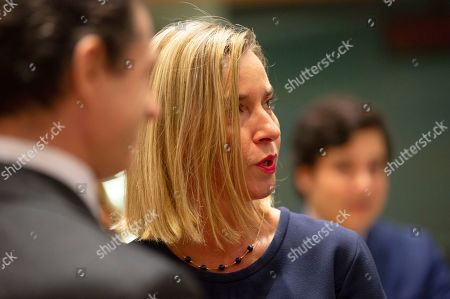 European Union foreign policy chief Federica Mogherini, right, attends a meeting of EU foreign ministers at the EU Council building in Brussels