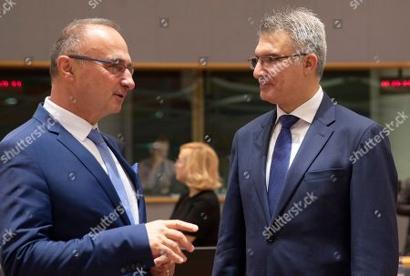 Stock Photo of Croatia's Minister for Development Gordan Grlic Radman, left, speaks with Malta's Minister of Foreign Affairs Carmelo Abela during a meeting of EU foreign ministers at the EU Council building in Brussels