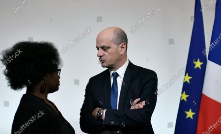 French Education and Youth Affairs Minister Jean-Michel Blanquer (R) speeks with French Government's spokesperson Sibeth Ndiaye (L) during a meeting on domestic violenceduring the International Day for the Elimination of Violence against Women in Paris, France, 25 November 2019.