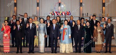 South Korean President Moon Jae-in (C) and leaders from the Association of Southeast Asian Nations pose before a dinner at their summit in Busan, South Korea, 25 November 2019, The ASEAN-ROK Commemorative Summit, which runs from 25 to 26 November, celebrates the 30th anniversary of the dialogue partnership between the Association of Southeast Asian Nations (ASEAN) and the Republic of Korea (ROK). In picture from left in the front row are Myanmar State Counsellor Aung San Suu Kyi, Sultan of Brunei Hassanal Bolkiah, Thai Prime Minister Prayut Chan-o-cha and his wife, Moon and first lady, Kim Jung-sook, Vietnamese Prime Minister Nguyen Xuan Phuc (R) and his wife, Indonesian President Joko Widodo and his wife. From left in the back row are Cambodian Deputy Prime Minister and Foreign Minister Prak Sokhonn, Singaporean Prime Minister Lee Hsien Loong and his wife, Philippine President Rodrigo Duterte and his wife, Malaysian Prime Minister Mahathir Mohamad and his wife, and Laos Prime Minister Thongloun Sisoulith and his wife.