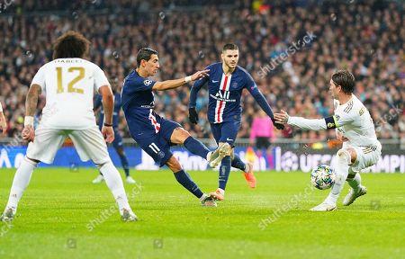 Sergio Ramos of Real Madrid blocks a shot from Angel Di Maria of Paris Saint-Germain