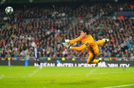 Goalkeeper Thibaut Courtois of Real Madrid makes a flying save