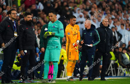 Goalkeeper Alphonse Areola of Real Madrid prepares to come on before the red card to Goalkeeper Thibaut Courtois of Real Madrid was rescinded