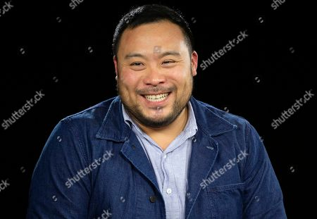 """FILE - This photo shows celebrity chef David Chang during an interview in Los Angeles. Airbnb is launching a global search for 100 top home cooks and treating them to a trip to Italy to learn how to refine their recipes with teachers including David Chang and his mom. he lucky chosen will travel to the University of Gastronomic Sciences in Pollenzo, Italy, for a week's worth of workshops and tastings to take their food """"to the next level."""" Their recipe will also feature in Airbnb's first cookbook"""