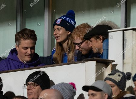 Ipswich Town and Musician Ed Sheeran watches from the stands with his wife Cherry Seaborn at Portman Road