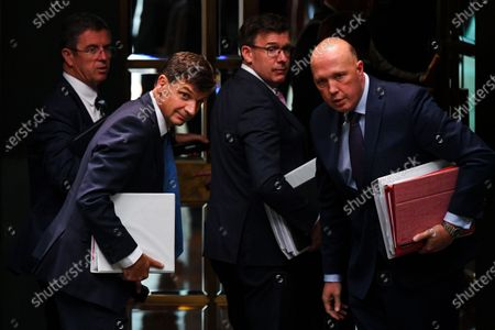 Australian Energy Minister Angus Taylor (L) leaves the House of Representatives during Question Time at Parliament House in Canberra, Australian Capital Territory, Australia, 25 November 2019. In picture at right is seen Minister for Home Affairs Peter Dutton.