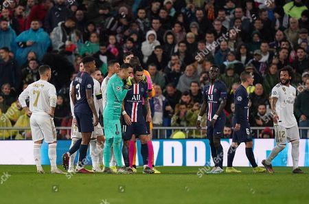 Paris Saint-Germain goalkeeper Keylor Navas talks to Angel Di Maria of Paris Saint-Germain as Goalkeeper Thibaut Courtois of Real Madrid is presented a red card in the first half.