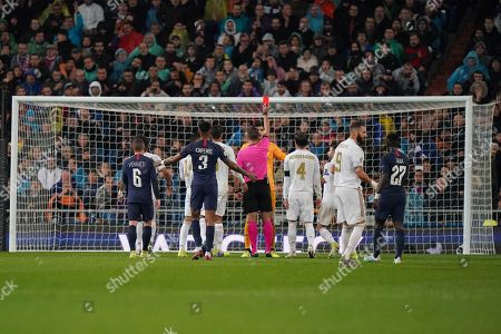 Referee Artur Manuel Soares Dias presents Goalkeeper Thibaut Courtois of Real Madrid a red card after a foul on Mauro Icardi of Paris Saint-Germain in the first half. The red card is subsequently overturned after a VAR check.