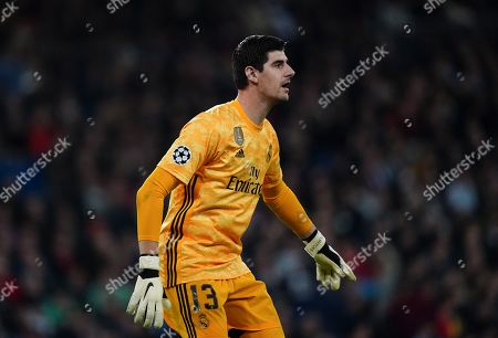 Goalkeeper Thibaut Courtois of Real Madrid watches the ball