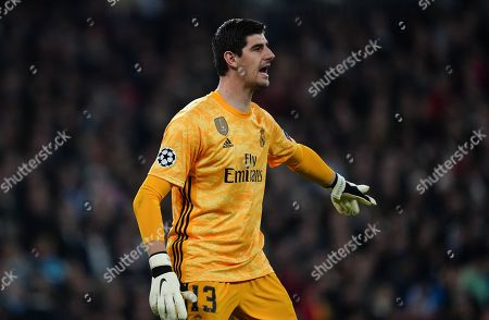 Goalkeeper Thibaut Courtois of Real Madrid shouts to his players