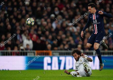 Julian Draxler of Paris Saint-Germain is tackled by Marcelo of Real Madrid