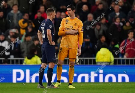 Goalkeeper Thibaut Courtois of Real Madrid talks to Thomas Meunier of Paris Saint-Germain after the full-time whistle
