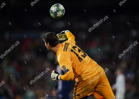 Goalkeeper Thibaut Courtois of Real Madrid throws the ball