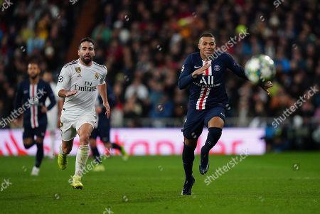Kylian Mbappé of Paris Saint-Germain and Dani Carvajal of Real Madrid run for the ball