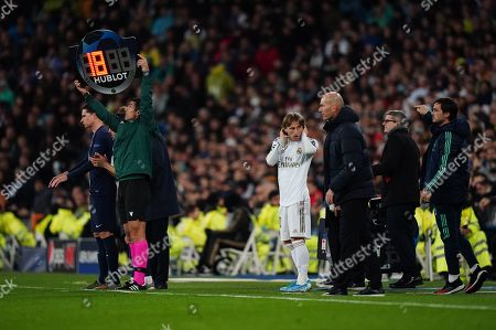 Luka Modric of Real Madrid prepares to be substituted on