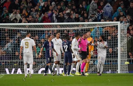 Marcelo of Real Madrid reacts to Referee Artur Manuel Soares Dias after he presents a red card to Goalkeeper Thibaut Courtois of Real Madrid in the first half. The red card is subsequently overturned after a VAR check.