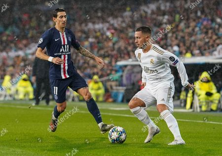 Eden Hazard of Real Madrid plays the ball around Angel Di Maria of Paris Saint-Germain
