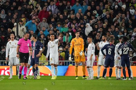 Casemiro of Real Madrid and the players react after Goalkeeper Thibaut Courtois of Real Madrid is presented a red card in the first half. The red card is subsequently overturned after a VAR check.