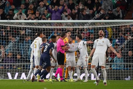 Sergio Ramos of Real Madrid and Marcelo of Real Madrid react to Referee Artur Manuel Soares Dias after he presents a red card to Goalkeeper Thibaut Courtois of Real Madrid in the first half. The red card is subsequently overturned after a VAR check.