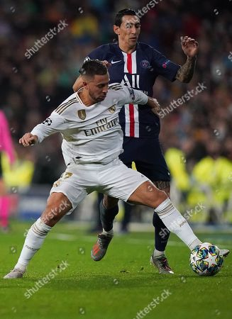 Eden Hazard of Real Madrid plays the ball past Angel Di Maria of Paris Saint-Germain